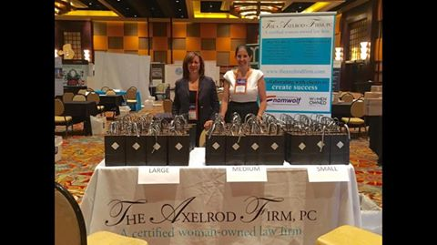 President Sheryl Axelrod and Partner Lisa Savitt at The Axelrod Firm's table, where they greeted fellow expo attendees and gave out gift bags containing awesome swag representing the firm