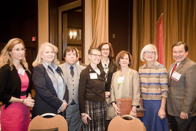 Lisa Savitt posing for a group photo with members of the ABA Section of International Law. To her left is Canadian Bar Association President, Janet Fuhrer, and to her right is Chief Justice of the Canadian Supreme Court, Beverly McLachlin.